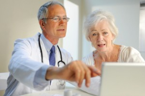 Doctor with Patient Reviewing Medical History