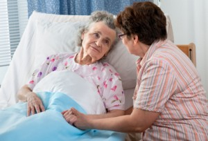 Working Family Caregiver Caring for Mother in Hospital