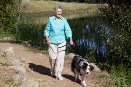 Senior Woman Walking Dog - Physical Activity from Daily Life Found to Reduce Risk of Alzheimer's