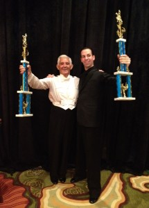 Alex Nastaskin with Paolo Di Lorenzo displaying Alex's Trophies